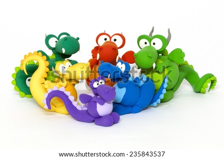 Multicolored handmade modeling clay dragons on white - stock photo