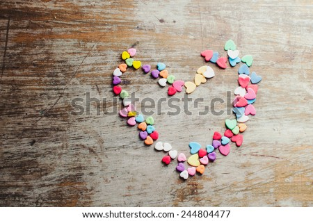 Multicolored hearts candy forming big heart   - stock photo
