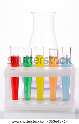 Multicolored liquid chemical tubes.  - stock photo