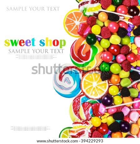multicolored lollipops, candy and chewing gum on a white background. text removed - stock photo