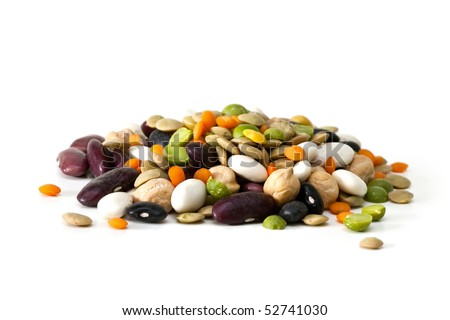 Multicolored mixed dried beans on a white background - stock photo