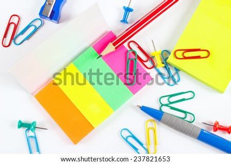 Multicolored office stationery on white desktop close up - stock photo