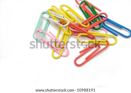 multicolored paper-clip on the white isolated background - stock photo