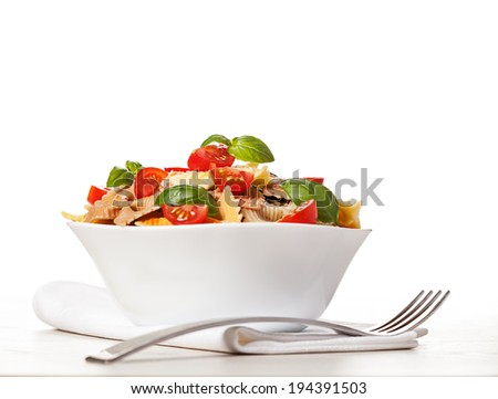 Multicolored pasta on light background - stock photo