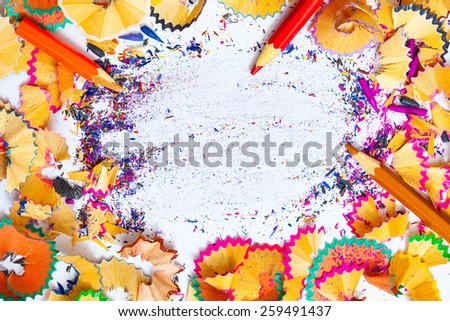 multicolored pencil shavings and copy space, still life - stock photo