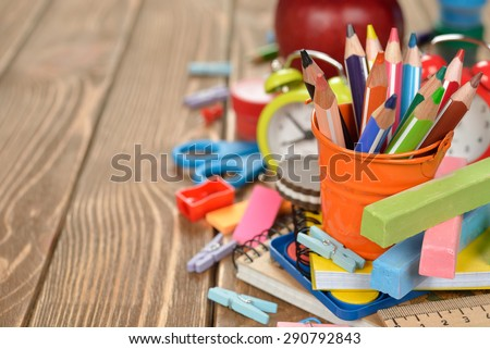 Multicolored pencils in a bucket on a brown background - stock photo