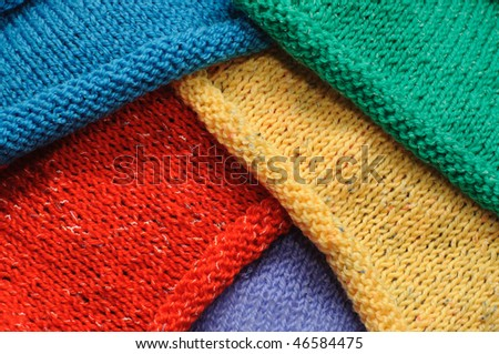 multicolored pieces of khitted fabric - stock photo
