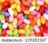 Multicolored pile of jelly beans for background image closeup - stock photo