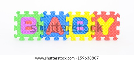 Multicolored plastic toy letters spelling the word Baby isolated on a white background.  - stock photo