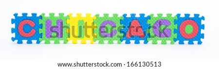 Multicolored plastic toy letters spelling the word Chicago city of the U.S. state of Illinois isolated on a white background.  - stock photo