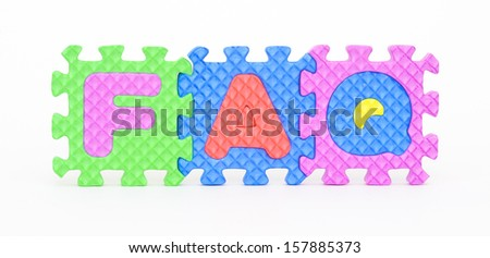 Multicolored plastic toy letters spelling the word FAQ isolated on a white background.  - stock photo
