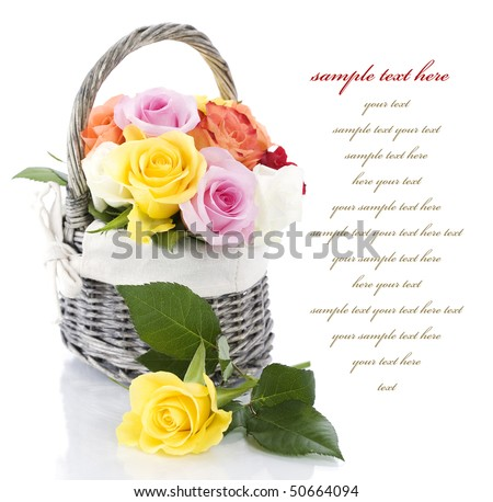 Multicolored roses in a basket over white  (with sample text) - stock photo