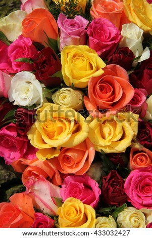 Multicolored roses with water drops in a mixed floral arrangement - stock photo