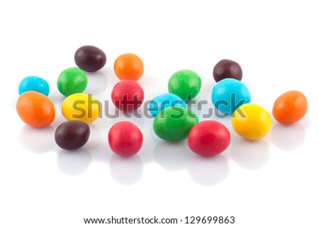Multicolored round candies on a white background. - stock photo