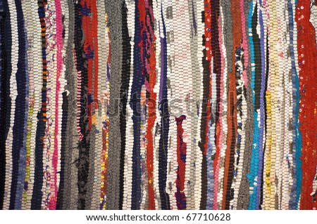 Multicolored rug, made of different pieces. Frontally, a fragment, closeup. - stock photo