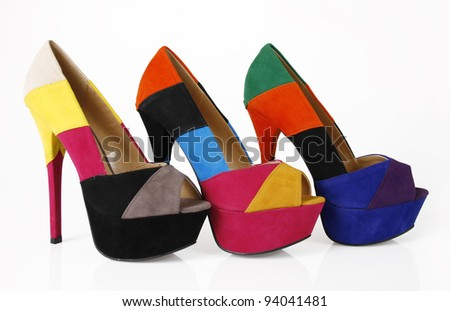 Multicolored shoes on a white background - stock photo
