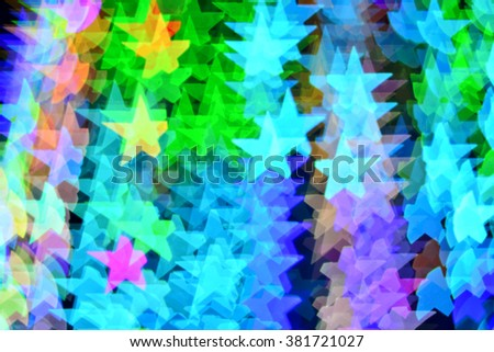 Multicolored star bokeh lights background. - stock photo
