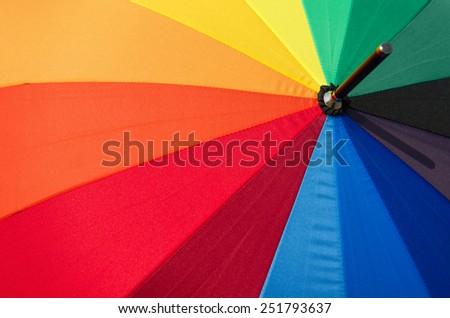 Multicolored the umbrella for a colorful background. - stock photo