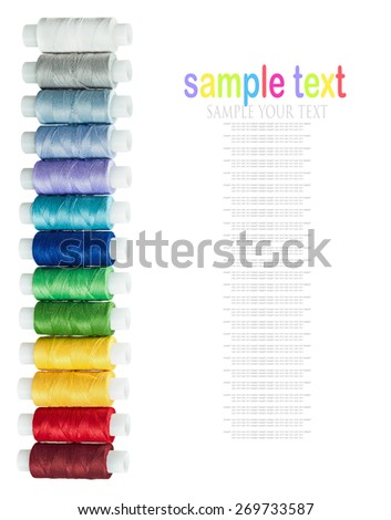 multicolored threads isolated on a white background. The text is an example and can be easily removed - stock photo