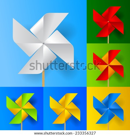 Multicolored toy paper windmill propeller set on backgrounds of different colors. Contain the Clipping Path of all objects - stock photo