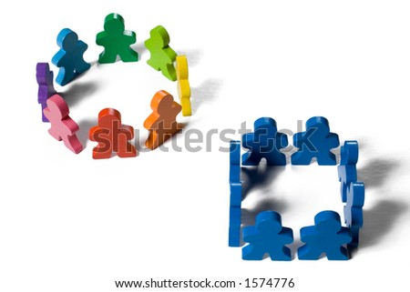 Multicolored wooden people illustrating a business concept - thinking outside the box or innovation. - stock photo