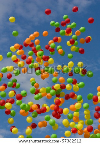 Multicoloured balloons against the blue sky - stock photo