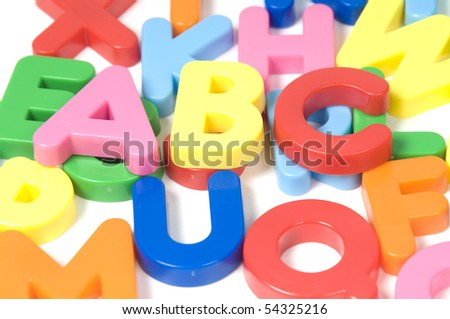 multicoloured bright plastic letters ABC on white background - stock photo