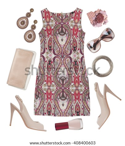 Multicoloured patterned dress, shoes, cosmetic and accessories isolated on white - stock photo