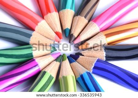 Multicoloured pencil in unique arrangement - stock photo