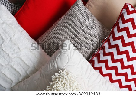 Multicoloured pillows closeup - stock photo