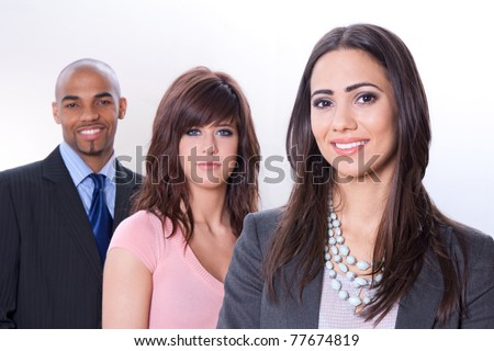 Multicultural business team, three smiling young people. - stock photo