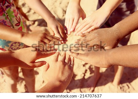 Multicultural childrens hands in a circle. Instagram effect - stock photo