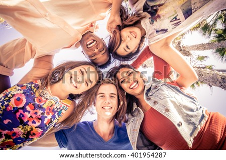 Multicutural group of young people having fun on a tropical beach - Friends on a summer holiday looking down at camera and laughing - stock photo