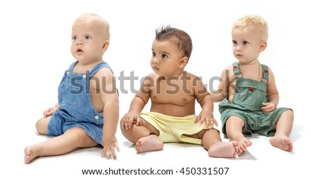 Multiethnic babies dancing on light background - stock photo