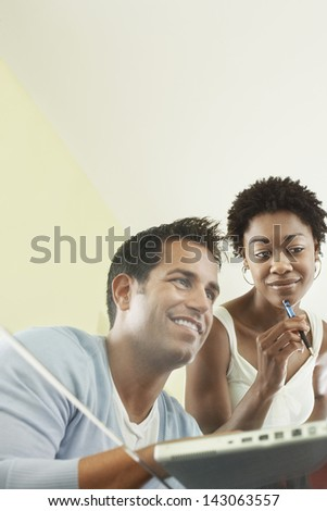Multiethnic business people busy working over laptop in conference room - stock photo