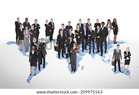 Multiethnic business people standing on world map representing global business.  - stock photo