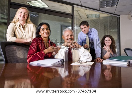 Multiethnic business team meeting in an office conference room - stock photo