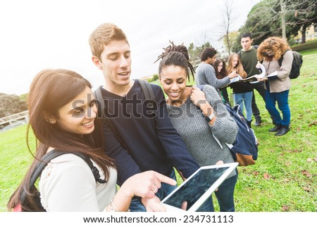 Multiethnic College Students at Park - stock photo
