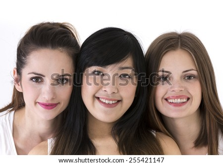 Multiethnic group of beautiful women. Isolated on white background. - stock photo