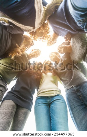 Multiethnic Group of Friends in a Circle - stock photo