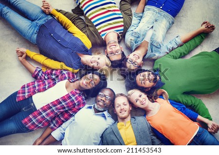 Multiethnic Group of People Holding Hands and Lying Down - stock photo
