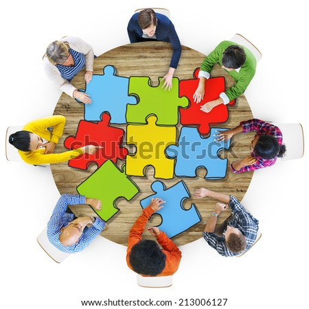 Multiethnic Group of People with Jigsaw Puzzle in Photo and illustration - stock photo