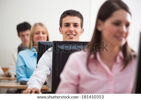 Multiethnic group of students in the computer lab. - stock photo