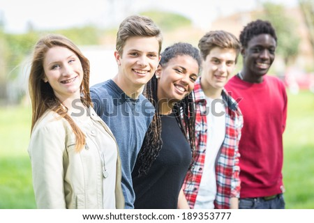 Multiethnic Group of Teenagers Outdoor - stock photo