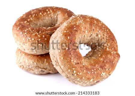 Multigrain bagel on white background, shallow focus - stock photo