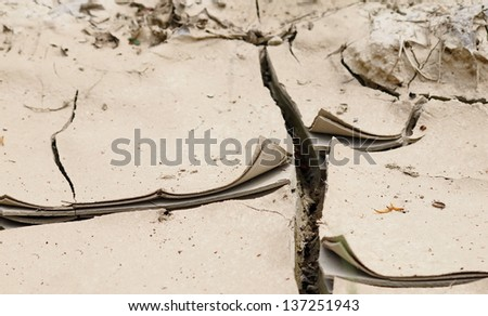 multilayer earth cracked because of drought - stock photo