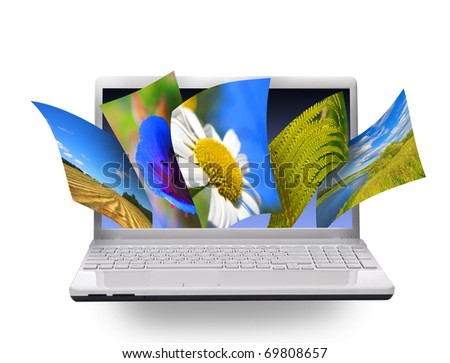 Multimedia concept with notebook. Isolated on white. - stock photo