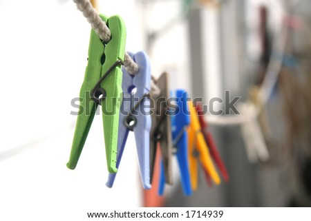 Multiple and colored clothes-pins - stock photo