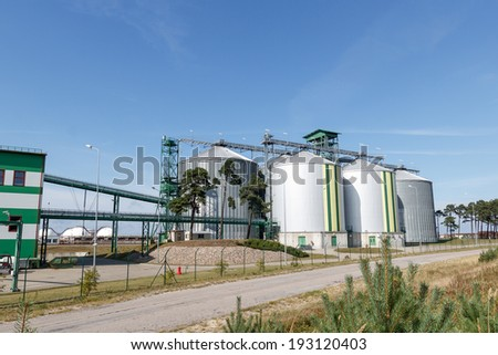 Multiple biological fuel storage tanks connected to the biofuel factory - stock photo