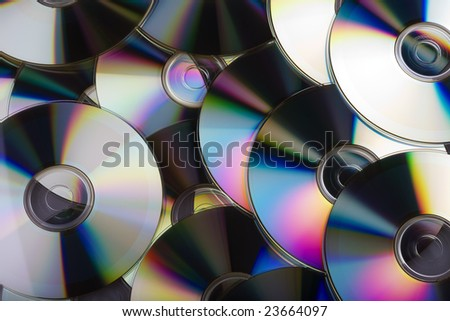Multiple compact disks overlapping each other, creating a colourful display - stock photo